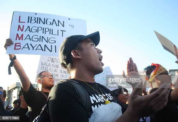 Filipino protesters participate in a rally at the People Power Monument in EDSA on Wednesday against the heros burial of former dictator Ferdinand...
