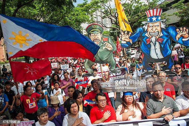 Filipino protestors march towards the Chinese consulate during an anti China protest rally on Philippine Independence Day on June 12 2015 in the...