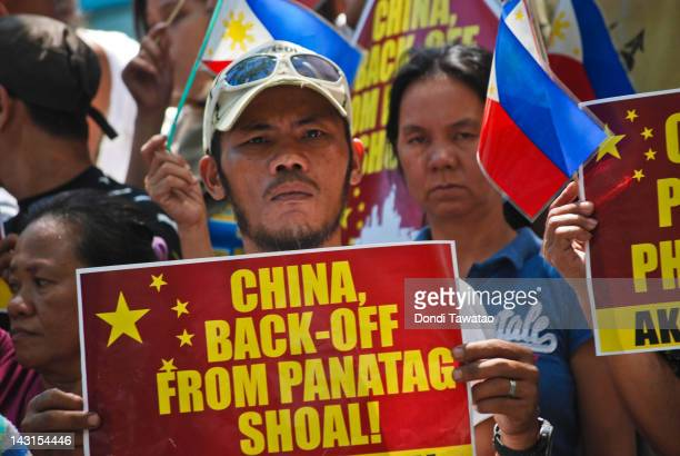 Filipino protestors stage a rally demanding China pull out of the contested Scarborough Shoal in the South China Sea outside the Chinese Embassy in...