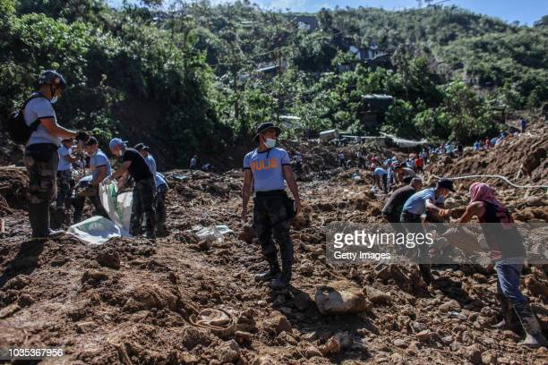 Filipino rescuers dig at the site where dozens of people were believed to have been buried by a landslide on September 18 2018 in in Itogon Benguet...