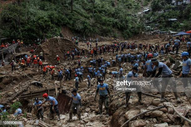 Filipino rescuers dig at the site where people were believed to have been buried by a landslide on September 19 2018 in Itogon Benguet province...