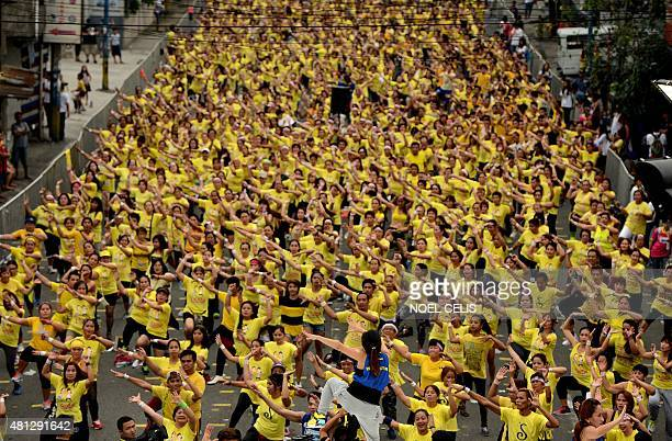 Filipino residents participate in a Zumba class in an attempt to break the Guinness World Record in Mandaluyong on July 19 2015 Residents broke the...