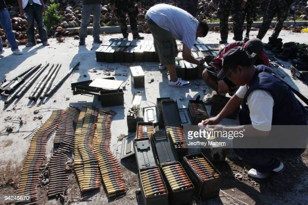 Filipino security forces seize sophisticated weapons and ammunition from the residence of a Muslim clan blamed for the November 23 massacre of 57...