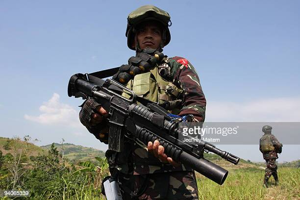 Filipino soldier secures the site where sophisticated weapons and ammunition were dug up on December 6 2009 in the restive southern Philippine...
