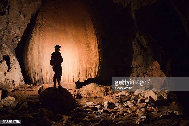 a filipino tour guide holds a lantern inside sumaging cave or big cave near sagada; luzon philippines - filipino culture stock photos and pictures