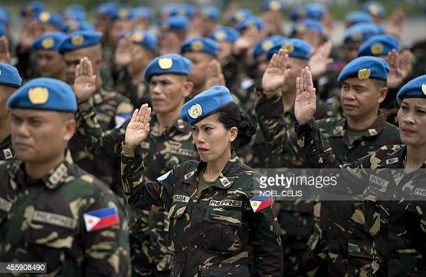 Filipino UN peacekeepers stand in formation during a send-off ceremony at the Villamor Airbase in Manila on September 22, 2014. The 157 soldiers will...
