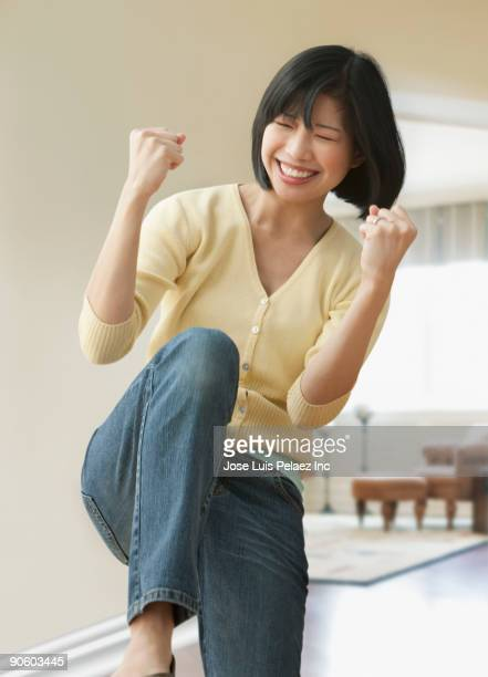 filipino woman celebrating - punching the air stock pictures, royalty-free photos & images