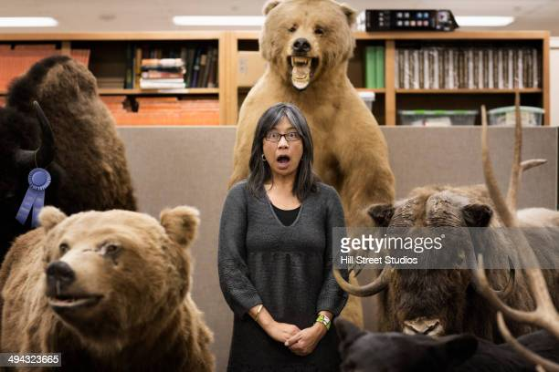 filipino woman gasping in natural history museum - tensed idaho stock photos and pictures
