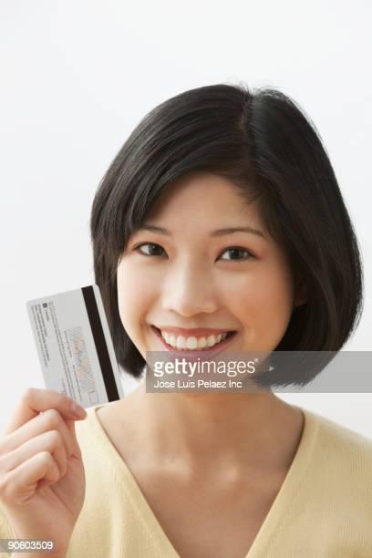 Filipino woman holding credit card