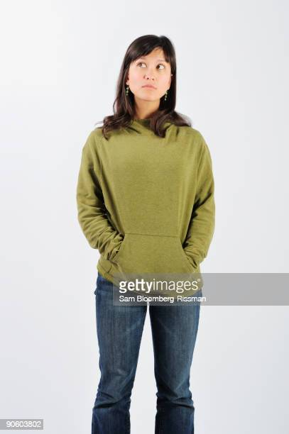 filipino woman looking up nervously - sweatshirt stock pictures, royalty-free photos & images