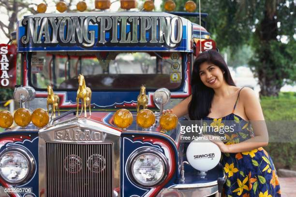 filipino woman posing by jeepneys - jeepney stock pictures, royalty-free photos & images