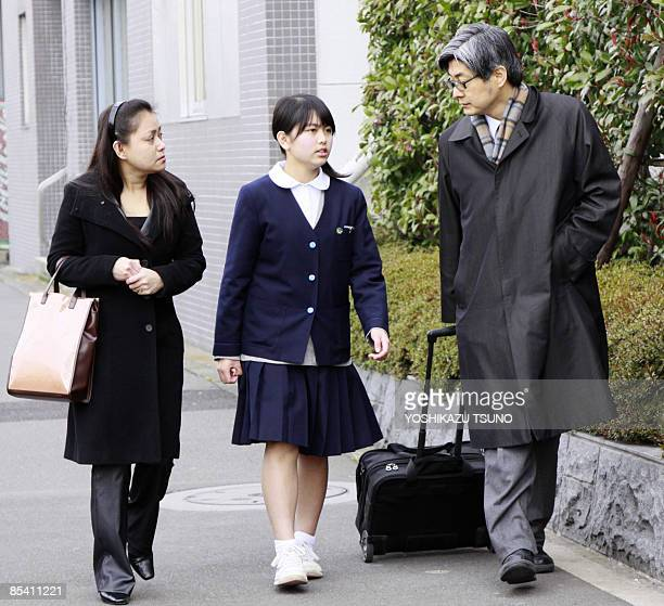 Filipino woman Sarah Calderon and her daughter Noriko accompanied by lawyer Shogo Watanabe arrive at the immigration office in Tokyo on March 13 2009...