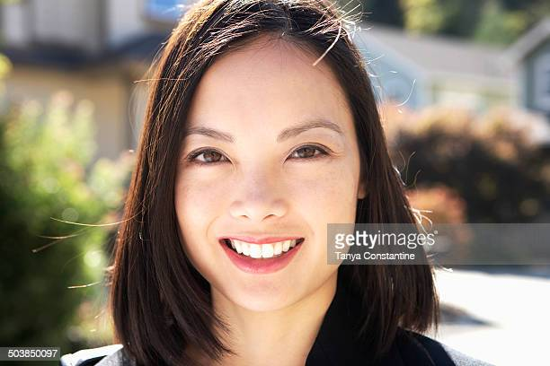 filipino woman smiling outdoors - filipino ethnicity and female not male stock pictures, royalty-free photos & images