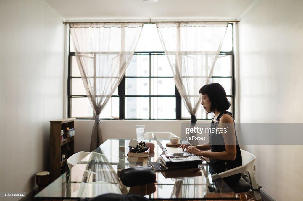 Filipino woman working on desk
