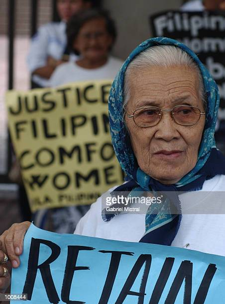 Filipino women display placards during a protest to express the plight of women who were used as comfort women or sex slaves by Japanese soldiers...