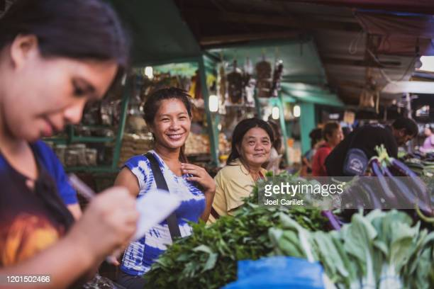 filipino women working at the market in puerto princesa, palawan - palawan stock pictures, royalty-free photos & images