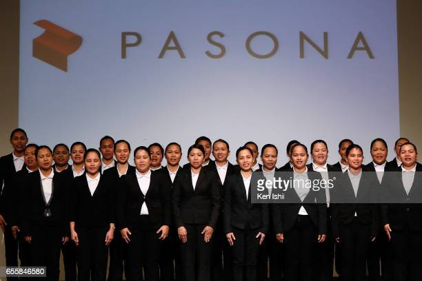 Filipino workers line up for their perform the welcome ceremony for the new recruits at the staffing company Pasona Inc headquarters on March 21 2017...