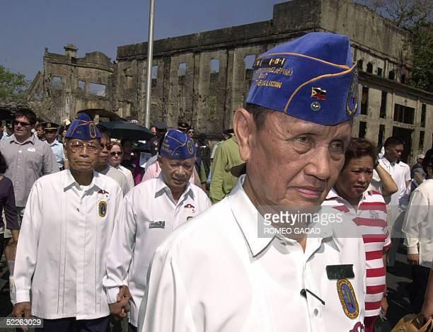 Filipino World War II veteran Arnulfo Banez followed by comrades tour the war memorial in Corregidor island near Manila 02 March 2005 Banez took part...