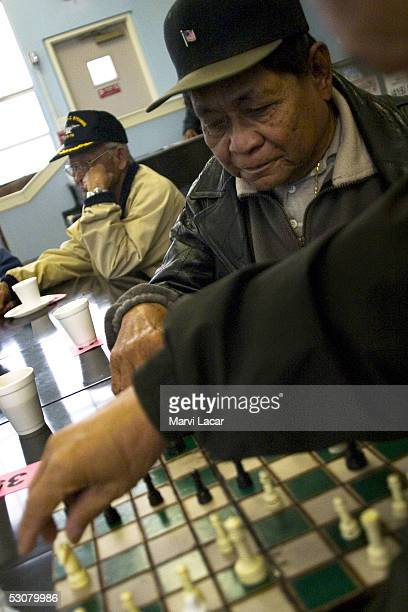 Filipino WWII veterans mingle with each other at one of the soup kitchens in the Tenderloin that serve senior citizens May 6 2005 in San Francisco...