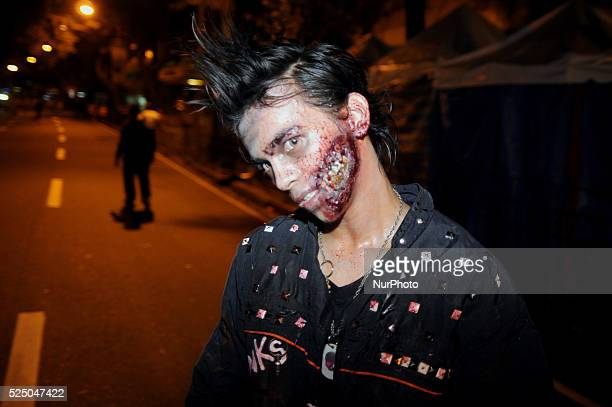 A Filipino 'zombie' takes part in the 'Makati After Dark' zombie run in the financial district of Makati east of Manila Philippines October 31 2013...