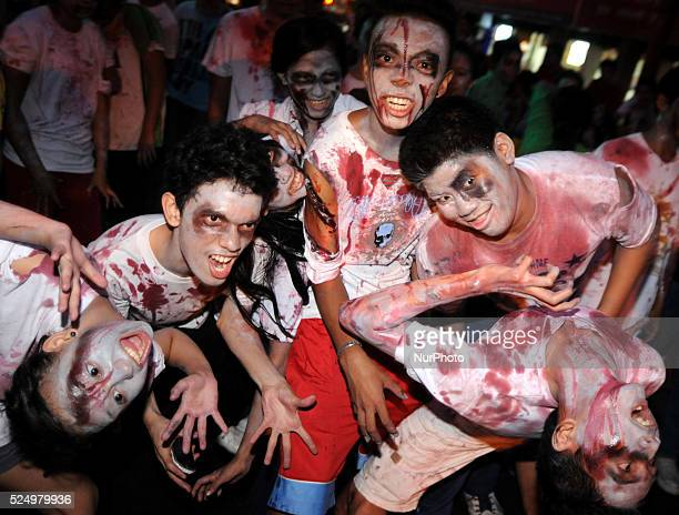 Filipino 'zombies' are seen during the 'Makati After Dark' zombie run in the financial district of Makati east of Manila Philippines October 31 2013...