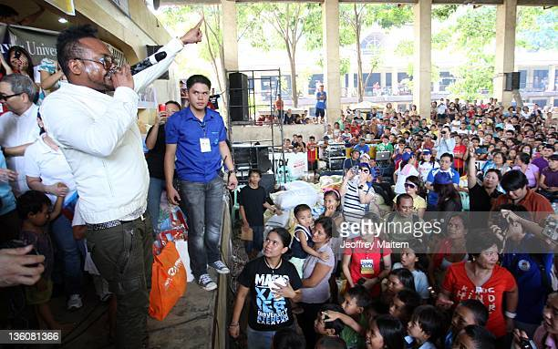 FilipinoAmerican Black Eyed Peas musician ApldeAp performs as he visited locals displaced by typhoon Washi and resulting floods at an evacuation...