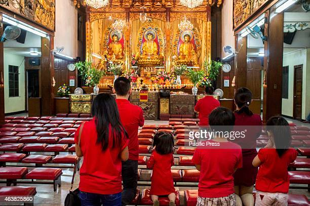 FilipinoChinese family kneels before the statue of Buddha inside Seng Guan Temple during the celebration of the Lunar New Year