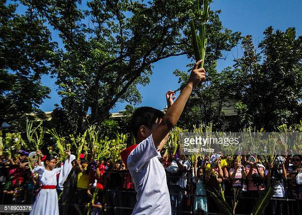 Filipinos attend mass at the Baclaran Church Palm Sunday marks the triumphant entry of Jesus Christ to Jerusalem kicking off the Holy Week for...