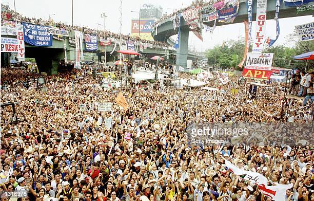 Filipinos cheer after Gloria Arroyo was sworn in as the Philippines'' new president January 20, 2001 at the EDSA shrine in Manila. Arroyo took over...