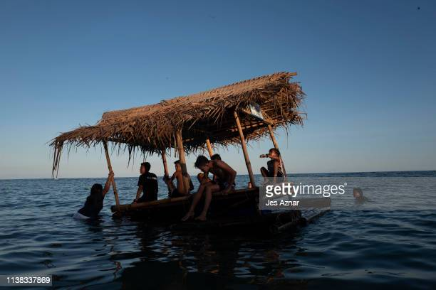 Filipinos cool down and enjoy the beach during the holy week break on April 20 2019 in Torrijos Marinduque in the Philippines The Philippines a...