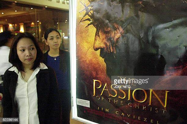 Filipinos head to theaters to watch Mel Gibson's controversial film The Passion of the Christ 31 March 2004 in Manila Two of the most talkedabout...
