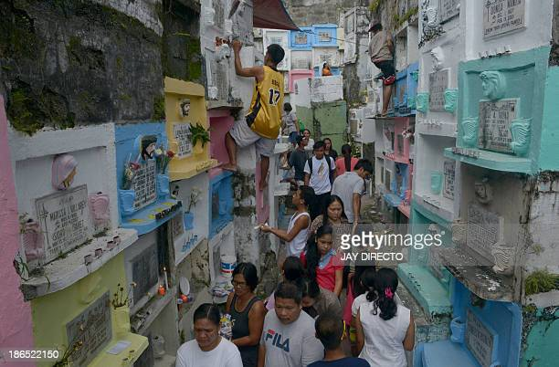Filipinos head towards cemeteries to honour the dead on All Saint's Day in Manila on November 1 2013 Millions across the Catholic Philippines trooped...