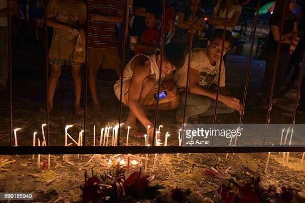 Filipinos offer flowers, candles, and prayers at the site of a recent deadly bomb blast in Davao City, Philippines, on September 4, 2016. The...
