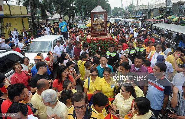 Filipinos transport an historical statue of Santo Nino or baby Jesus brought from Cebu island in the central Philippines during a procession in...