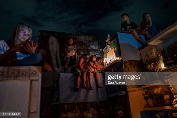 Filipinos visit the graves of their departed relatives and loved ones at a public cemetery as they mark All Saints' Day on November 1 2019 in Manila...
