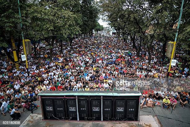 Filipinos watch a public live screening of Manny Pacquiao's match against Brandon Rios in Marikina city east of Manila Philippines November 24 2013...