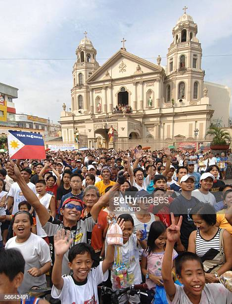 Filipinos waves Philippine flag in jubilation in Manila 22 January 2006 after Manny Pacquiao beat Mexican fighter Erik Morales in a grudge match in...