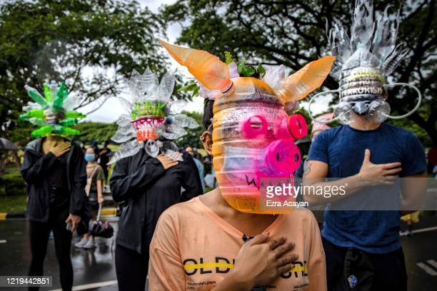 Filipinos wearing face masks made of recycled plastic bottles take part in a protest against President Duterte's Anti-Terror bill on June 12, 2020 in...