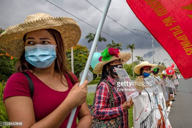 Filipinos wearing face masks take part in a protest against President Duterte's Anti-Terror bill on June 12, 2020 in Quezon city, Metro Manila,...