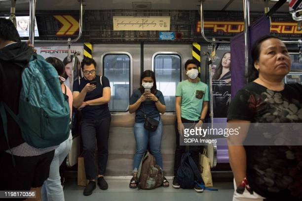 Filipinos wearing facemasks on a train following the virus outbreak Fear continues to mount in the Philippines over a new corona virus known as...
