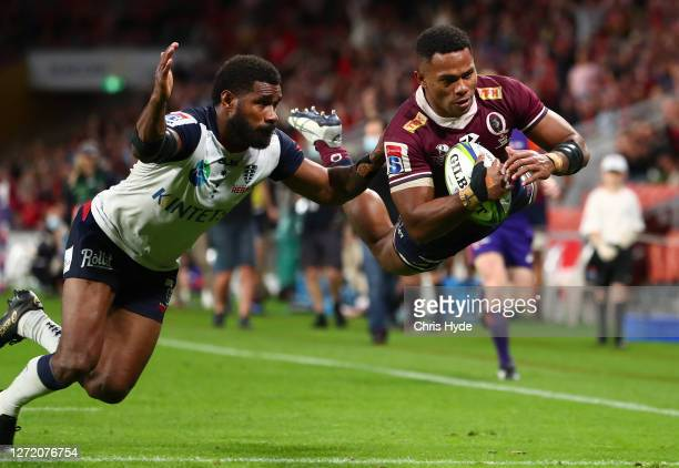 Filipo Daugunu of the Reds scores a try during the Qualifying Final Super Rugby AU match between the Queensland Reds and Melbourne Rebels at Suncorp...