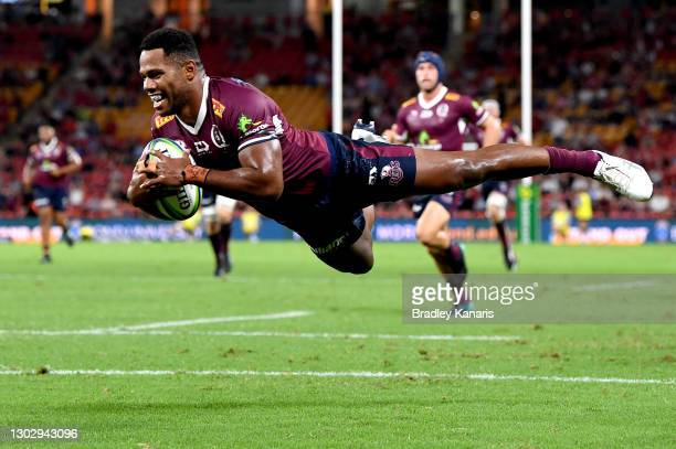 Filipo Daugunu of the Reds scores a try during the round one Super Rugby AU match between the Queensland Reds and the New South Wales Waratahs at...