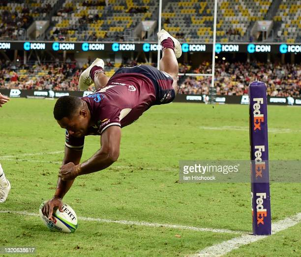 Filipo Daugunu of the Reds scores a try during the round three Super Rugby Trans-Tasman match between the Queensland Reds and the Chiefs at...