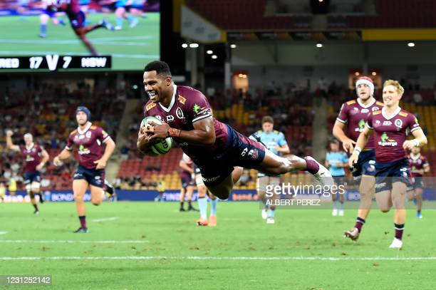 Filipo Daugunu of the Reds scores a try during the Super Rugby match between the Queensland Reds and NSW Waratahs at Suncorp Stadium in Brisbane on...