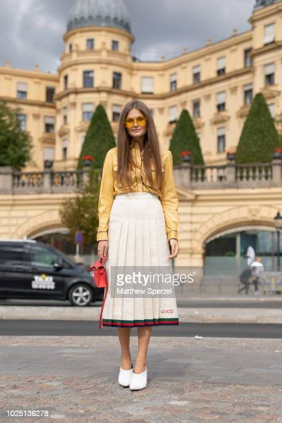 Filippa Haegg is seen on the street during Fashion Week Stockholm SS19 wearing a yellow blouse with Gucci pleated skirt on August 29 2018 in...