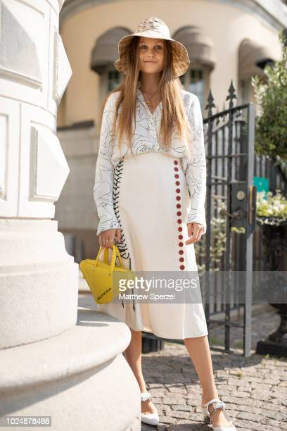Filippa Haegg is seen on the street during Fashion Week Stockholm wearing bucket hat and carrying a yellow Balenciaga bag on August 28 2018 in...
