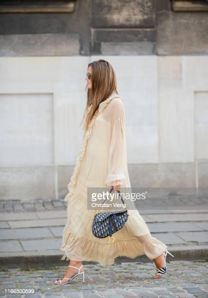 Filippa Haegg is seen wearing beige dress, Dior saddle bag, heels outside Mykke Hofmann during Copenhagen Fashion Week Spring/Summer 2020 on August...