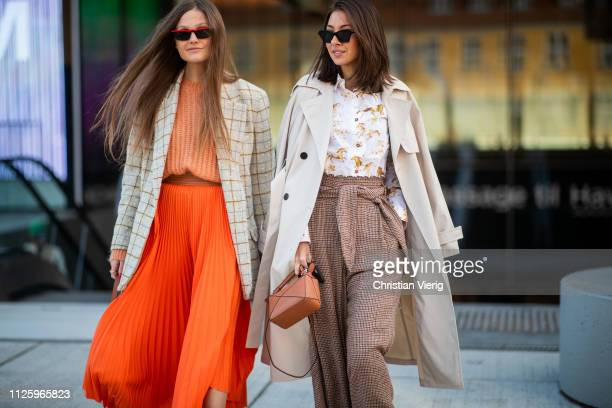Filippa Haegg is seen wearing brown Chloe bag orange skirt knit checked blazer jacket and Felicia Akerstrom Ma is seen wearing Ganni blouse creme...