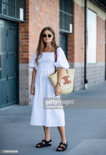 Filippa Haegg is seen wearing white dress, Celine basket bag, Chanel sandals during Stockholm Fashion Week Digital Edition 2020 on August 25, 2020 in...