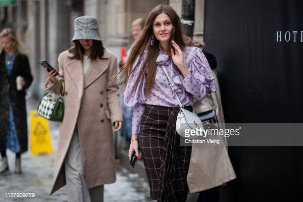 Filippa Haegg wearing plaid skirt and blouse with dots print and Felicia Akerstrom Ma wearing bucket hat, beige wool coat and Mulberry bag is seen...